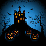 Halloween blue night with haunted castle and grinning pumpkins Royalty Free Stock Photography