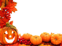 Halloween border. With jack-o-lantern, pumkins, and fall leaves Royalty Free Stock Photography