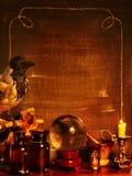 Halloween border with crystal ball. Vintage Stock Photos