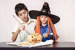 Halloween boy and girl painting pumpkin Royalty Free Stock Image