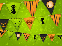 Halloween bunting on green background Stock Images