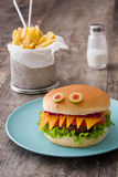 Halloween burger monsters on wood Royalty Free Stock Image