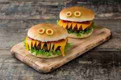 Halloween burger monsters on wood Royalty Free Stock Photos
