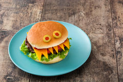 Halloween burger monsters on wood Stock Photo