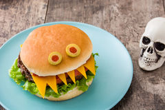 Halloween burger monsters on wood Stock Images