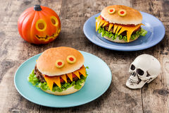 Halloween burger monsters on wood Royalty Free Stock Photography