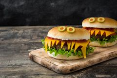 Halloween burger monsters on wood Royalty Free Stock Photo
