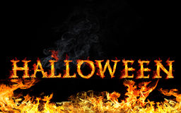 Halloween. Burning Halloween text and fire on black background Royalty Free Stock Images