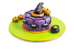 Halloween cake. A cake decorated for halloween with spiders, pumpkins and stars royalty free stock image