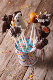 Halloween cake pop decorated with icing on the table. vertical Stock Photos