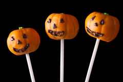 Halloween cake pop pumpkin jack close up  on a black Royalty Free Stock Photography