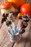 Halloween cake pop on the table and pumpkins. vertical Royalty Free Stock Photography