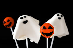 Halloween cake pops with phantom and pumpkin shape isolated on black background Royalty Free Stock Photos