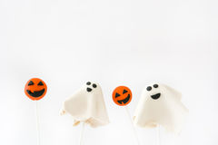 Halloween cake pops with phantom and pumpkin shape isolated on white background Royalty Free Stock Photo