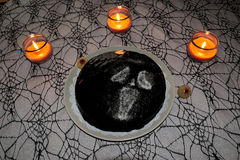 Halloween cake on spider web table cloth with candles stock photography