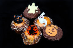 Halloween cakes. On a black background with copyspace stock images