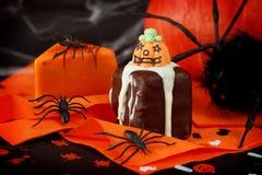 Halloween cakes. On orange serviette Royalty Free Stock Photography