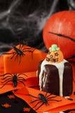 Halloween cakes. And orange decoration Stock Photos