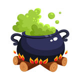Halloween caldron, cauldron with boiling green potion on wood fire Stock Photos
