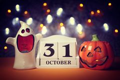 Halloween calendar date. 31st October with pumpkin and ghost royalty free stock photo