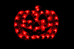 Halloween Camouflage Pumpkin with Lights. Isolated on a black background stock photos