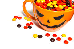 Halloween candies. Halloween candy in orange cup with face Royalty Free Stock Photos