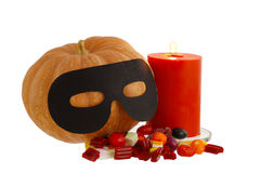 Halloween candies with candle Royalty Free Stock Image