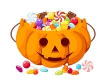 Halloween candies in Jack-O-Lantern bag. Stock Photos