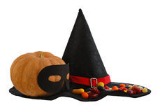 Halloween candies and masqueraded pumpkin isolated Royalty Free Stock Photos