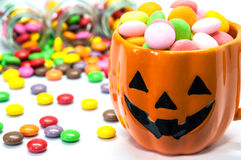 Halloween candies. In pumpkin cup stock photos