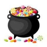 Halloween candies in witches cauldron. Halloween colorful candies in old witches cauldron Stock Photo