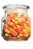 Halloween Candy. Corn and pumpkin filled glass jar Royalty Free Stock Photos