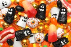 Halloween candy background. Halloween background of mixed candies, orange and black theme Royalty Free Stock Photo