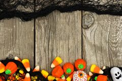 Halloween candy and black cloth double border against rustic wood Stock Photography