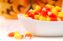 Halloween candy corn in a bowl. Sweet Halloween Candy Corn in a White Bowl royalty free stock images