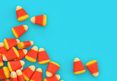 Halloween candy corn corner border over blue. Background with copy space stock photography