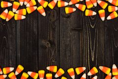 Halloween candy corn double border on dark wood Royalty Free Stock Photos