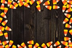 Halloween candy corn frame on dark wood Royalty Free Stock Images