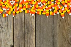Halloween candy corn top border over old wood Stock Photo