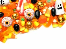 Halloween candy corner border. Over a white background Stock Photos