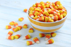 Halloween candy corns. In bowl on blue wooden background stock photography