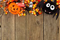 Halloween candy and decor top border over rustic wood Royalty Free Stock Image