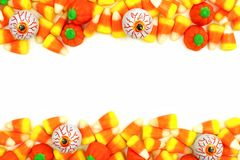 Halloween candy double border over white. Halloween candy double border or frame against a white background Royalty Free Stock Image