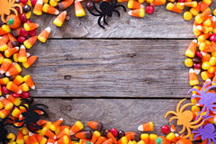 Halloween candy frame around rustic board. Empty space for your text Royalty Free Stock Photography