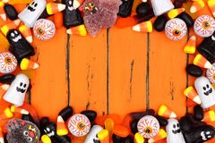 Halloween candy frame over old orange wood Royalty Free Stock Photos