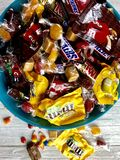 Halloween candy. Halloween candies in a blue bowl royalty free stock image