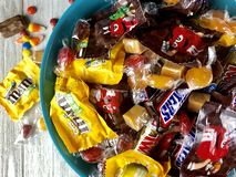 Halloween candy. Halloween candies in a blue bowl stock images