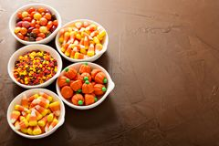 Halloween candy in little white bowls. Assorted Halloween candy in little white bowls stock photo