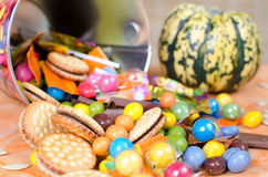Halloween Candy. Many sweets for Halloween in the bucket stock images