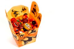 Halloween candy in orange chinese container. Colorful halloween candy in orange chinese container Royalty Free Stock Image